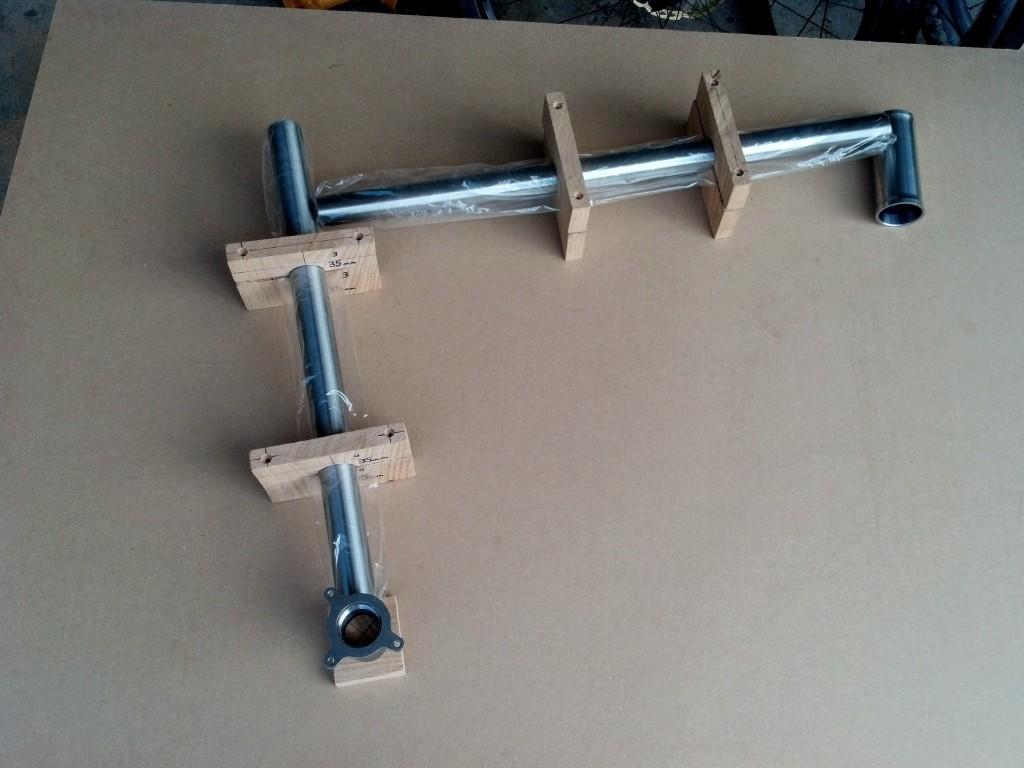 Homemade frame jig out of medium density fiberboard and oak wood blocks.