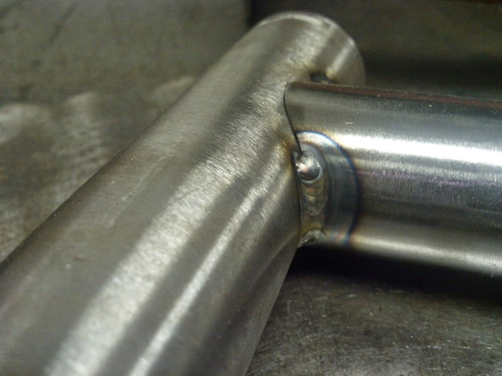 Tack welded seat tube top tube junction
